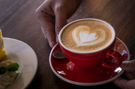 the red cup coffee love , coffee dark in wood dark table