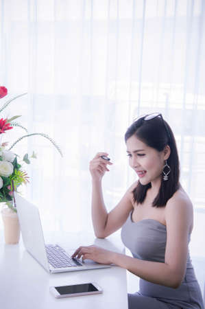 Smart girls working on notebook , Workingwoman using laptop in the room Stock Photo