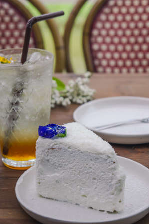coconut cake dessert on wood table , tasty cake