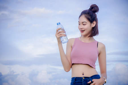 healthy girls drinking water in the bottle , drink for thirstily for Refreshing Stock Photo