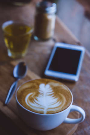 coffee hot drink cappucino latte art on wood vintage table , coffee time on wood background cafe Stockfoto