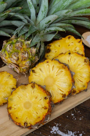 pineapple juice and piece of fruits ready to eat on the wood table