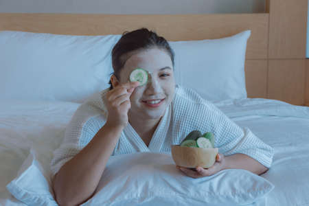 girls happy time of Face Mask pad cucumber, Cucumber moisturizing Beneficial to the skin , beauty skill massage spa of yourself Stock Photo