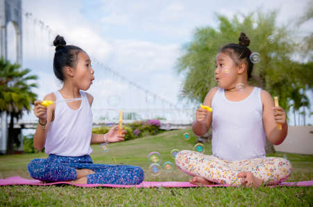 Girs play and Enjoy activities Blow bubbles in the park , Friendship in Childrens Day
