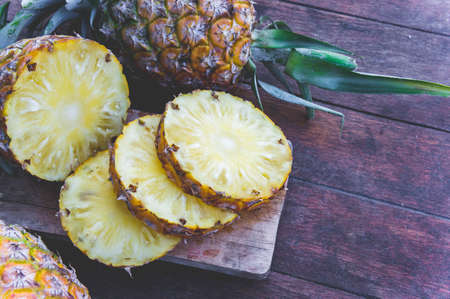 pineapple fruit on wood table Stock Photo