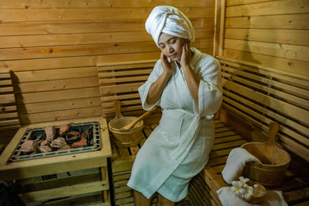 girls in the Sauna room , Refreshing in tropical wood room. To keep the body healthy