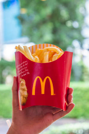 Udon Thani , Thailand , 20 May 2018 in the mcdonalds Restaurant Udon Thani , fast food restaurant Fast Food Sales a hamburger French fries nuggets and beverage in the shop