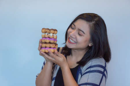happy woman eating donuts