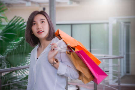 Woman smiling and hold shopping bag Stok Fotoğraf