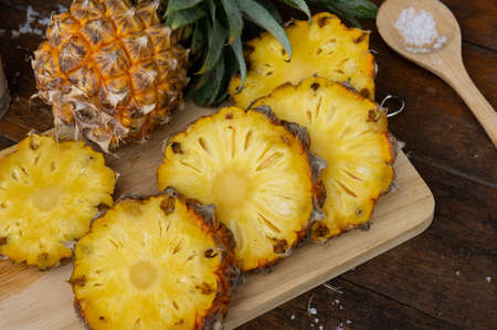 Pineapple juice and piece of fruits ready to eat on the wood table Stock Photo