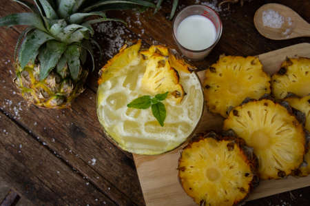 Pineapple juice and piece of fruits ready to eat on the wood table Stok Fotoğraf