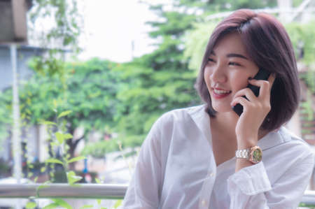 Asian girl's smiling and using smart phone