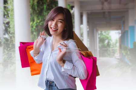 Happy woman smile and holding shopping bags shopping on the day Stok Fotoğraf
