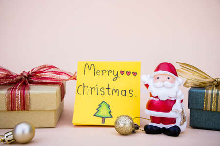 Santa claus doll christmas  and gift box and copy space Stock Photo