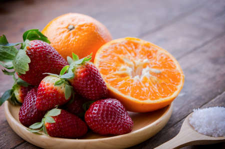 Strawberry and orange fruit vitamin diet for healthy Stock Photo
