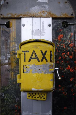 old and dirty taxi sign in a rainy afternoon photo