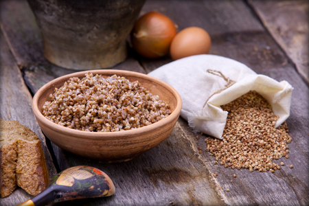 russian food: Buckwheat on the old desk Russian food