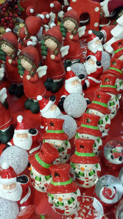 clauses: Snowmen, Santa Clauses and angels. The colors red, green and white.
