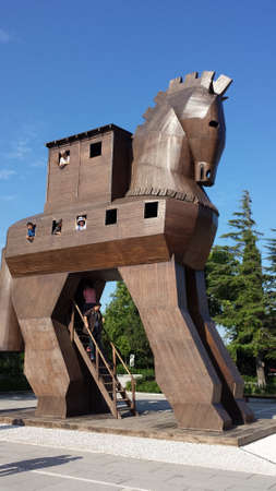 Tourists inside the Trojan horse. They look through the windows Editorial
