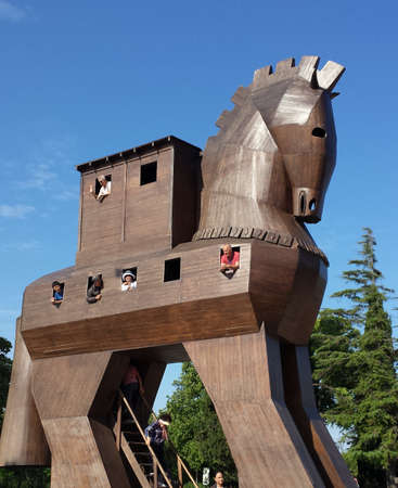 trojan: Tourists inside the Trojan horse. They look through the windows Editorial