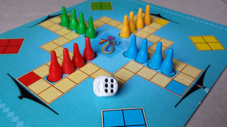 pawns: Board game - chinese, colorful pawns and dice Stock Photo