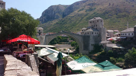 Mostar, Bosnia and Herzegovina - July 25, 2017: Peoples on the reconstructed Old Bridge of Mostar on the river Neretva, Bosnia and Herzegovina