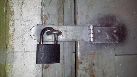 Door locked for a padlock Imagens
