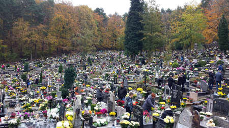 Gdynia, Poland - November 01, 2017: All Saints Day in the cemetery. People visit the graves of the dead, bring flowers and candles. Editorial