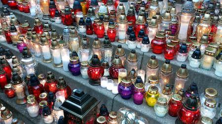 Various grave lights lit on All Saints Day