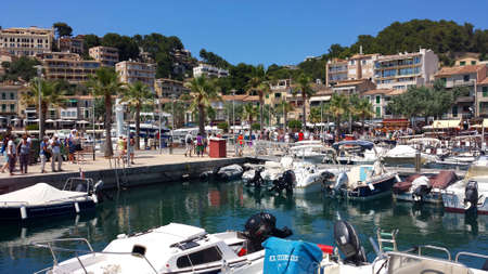 Port de Soller, Mallorca: June 21, 2018: Yachts and boats in the harbor of the lively resort town of Port de Soller.