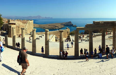 Lindos, Rhodes, Greece - September 4, 2018: Tourists visit the ruins of the Acropolis. Redakční