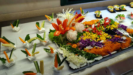 Floral decorations made of different vegetables.