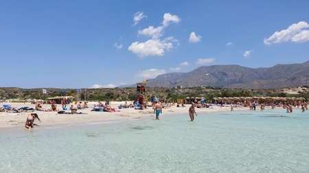Crete, Greece - June 20, 2019: People on Elafonisi beach with crystal clear water and pink sand. Redakční