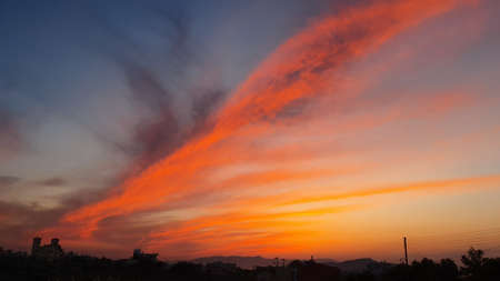 Orange-purple, fiery sunset on Crete, Greece.