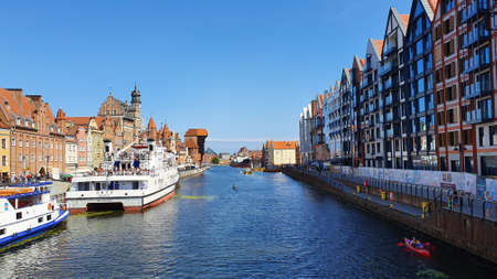 Gdansk, Poland - August 3, 2019: A classic view of the old city of Gdansk on the Motlawa River.