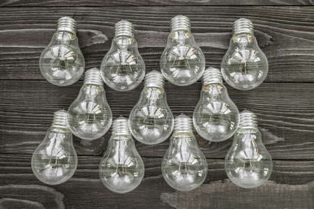 incandescent: incandescent lamps on the wooden rustic background Stock Photo