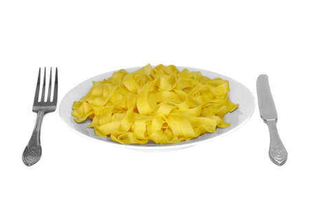 Yellow pasta on gray plate photo