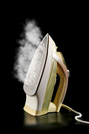 steamy: Steamy electric iron reflected on a black background Stock Photo