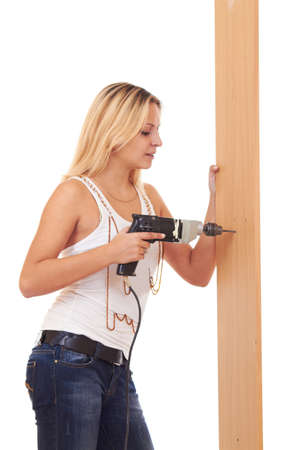 Young girl is drilling the wall with electrical perforator Stock Photo - 8225438