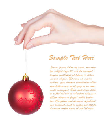 Postcard with sample text and image of a girl holding a christmas-tree ball hanged on a string isolated on white Stock Photo - 8305602