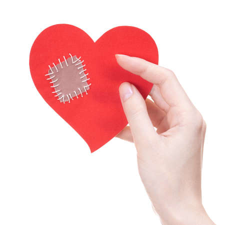 patch: Woman holding Valentines day greeting card in a shape of broken heart with a patch