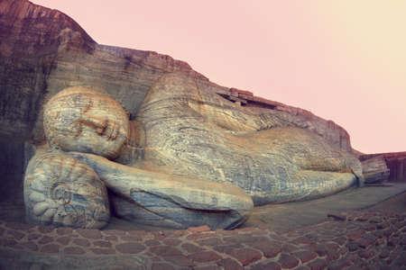 buddha sri lanka: Sleeping Buddha statue in Polonnaruwa, Sri-Lanka. Buddha attained nirvana, and lay down to sleep.