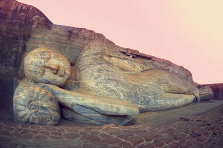 nirvana: Sleeping Buddha statue in Polonnaruwa, Sri-Lanka. Buddha attained nirvana, and lay down to sleep.