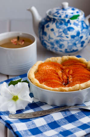 Apricot tart served with green tea photo