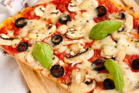 Pizza with mushrooms and cheese photo
