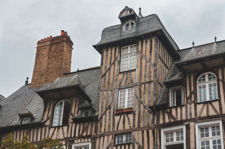 Close up of historic half-timbered houses with chimneys in old town of Rennes (Brittany, France)