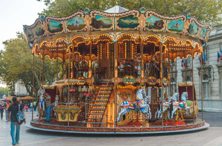 AVIGNON, FRANCE - OCTOBER 8, 2009: Illuminated retro carousel for children on Place de l'Horloge in centre of Avignon