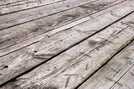 White boardwalk of stripped weathered washed out wooden planks with scratches. Imagens