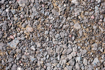 Crushed ballast gravel stone on ground. For texture and background