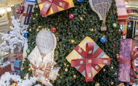 MOSCOW - 30 NOVEMBER, 2017: Fragment of huge Christmas tree decorated with big presents, baubles and lights in shopping mall